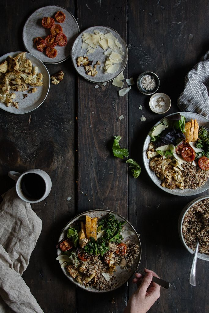 warm grain bowl with quinoa, roasted cauliflower, & spicy chicken / two red bowls