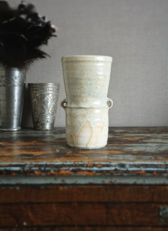 Hand-thrown stoneware vase w. light glaze.