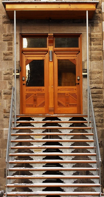 Montreal, 08 January 2012. The 3861, 3863, rue Saint-André.    Built: 1900.  Front (west elevation).  The stairway right to fly based on the way home from a ladder.  Transom doors, fine woodwork with interesting ornaments. Beautiful restoration.
