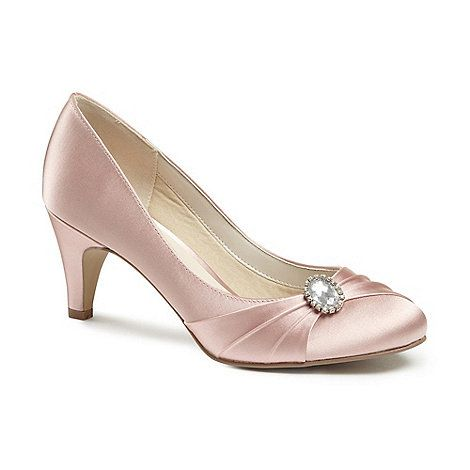 The stunnig 'Harmony' round toe court shoe, set off with intricate pleated detailing and set off with a vintage style trim. Memory foam padding and soft cotton lining makes this style extra comfortable.