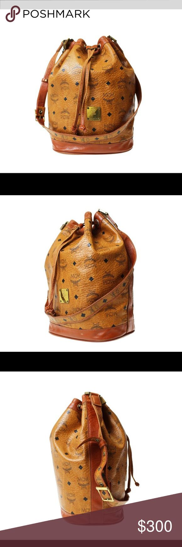 """Authentic MCM Bucket Bag Vintage Authentic MCM Bucket Bag. 13.7"""" tall. 9.4"""" long. Adjustable strap. Good condition. Price negotiable. MCM Bags Shoulder Bags"""