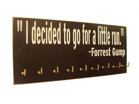 running medals display Forrest Gump by runningonthewall on Etsy {Looks like I found what I want to do with all my race medals.}
