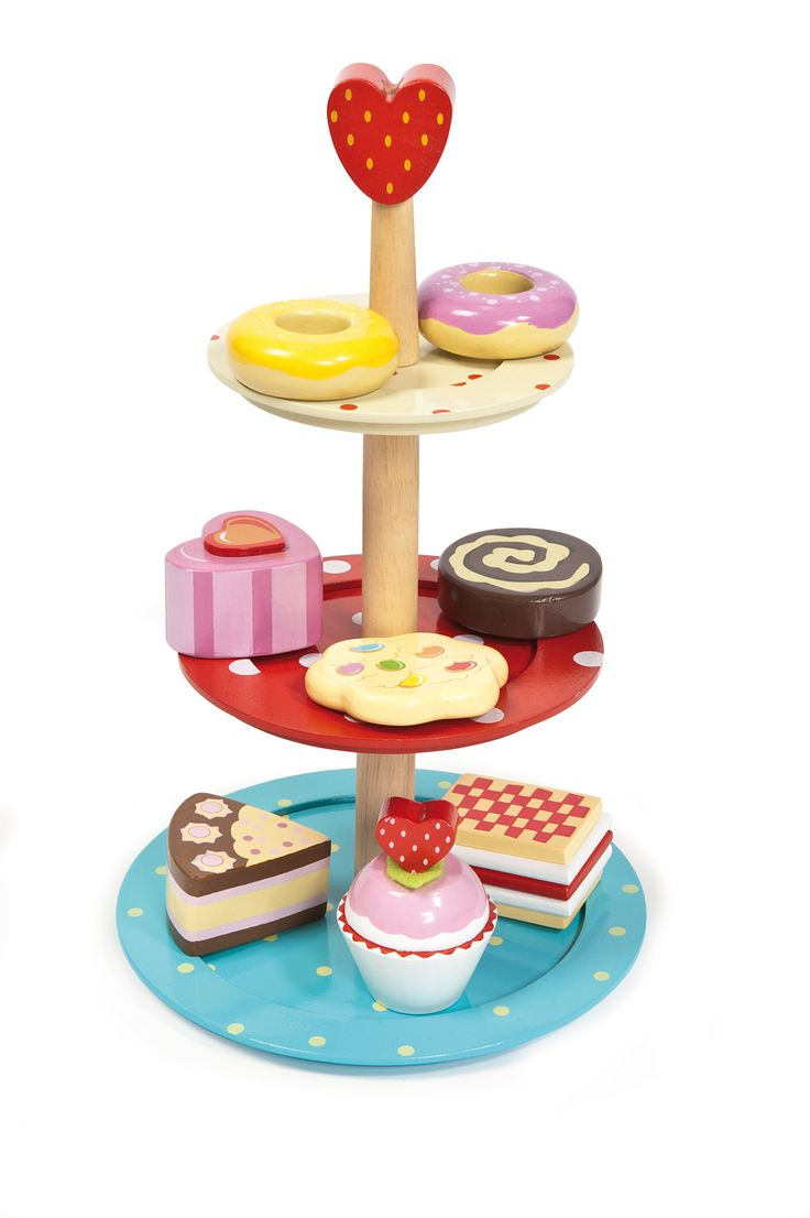 Le Toy Van Cake Stand This gorgeous 3 tier wooden Le Toy Van wooden cake stand is set to make any high tea party a success. With 8 colourful and delicious looking cakes, slices and biscuts the Honeybake Wooden Cake Stand set by Le Toy Van is an absolute must for any playroom. The cake stand is 30cm high . Made from environmentally friendly timbers and uses safe and non toxic paints