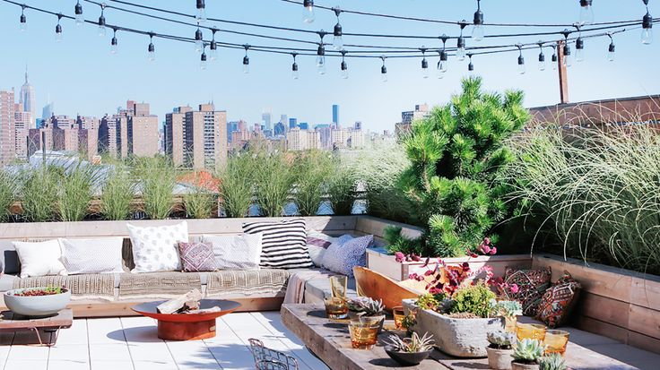 The Most Gorgeous Urban Rooftop Gardens// string lights, succulents, fire pit, throw pillows