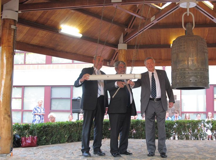 UNIC Canberra Director ringing the Peace Bell.