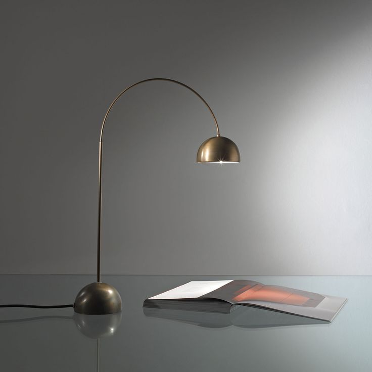 Satellite CG 45. Table lamp in dark oxidated brass. Snap-fit stalk with rotation 360°. By Carlo Giorgi   Laura Meroni