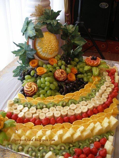 Fruit carving arrangements and food garnishes popular