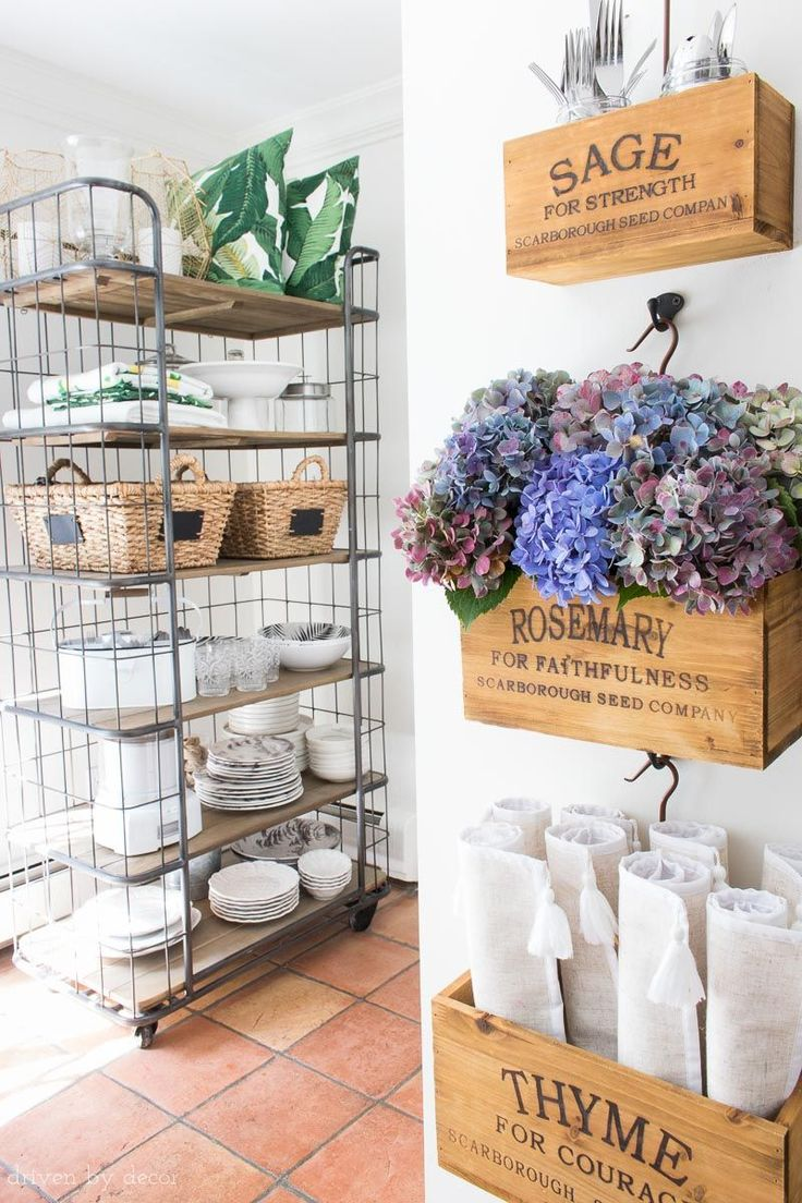 Loving the farmhouse style herb crates hanging on the wall and the open baker's rack - perfect for storing kitchen necessities! Also love the fall hued hydrangeas!