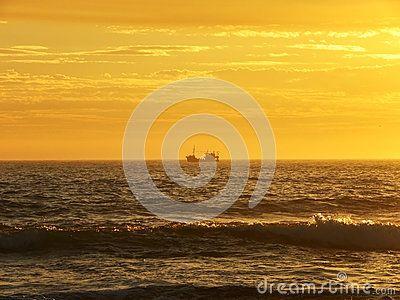 A view of a fishing trawler doing evening fishing.