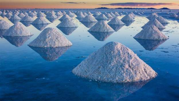 Salar de Uyuni, Bolivia. Salar de Uyuni is a magical place: When covered by water, the world's largest salt flat becomes a mirror, and anyone walking across it appears to be walking on clouds. The salt crust, which covers 4,086 square miles in southwestern Bolivia at 11,995 feet above sea level, ...
