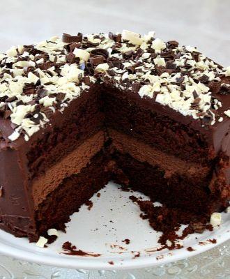Chocolate Cheesecake Cake #recipe - 2 layers of chocolate cake surrounding a layer of chocolate cheesecake.