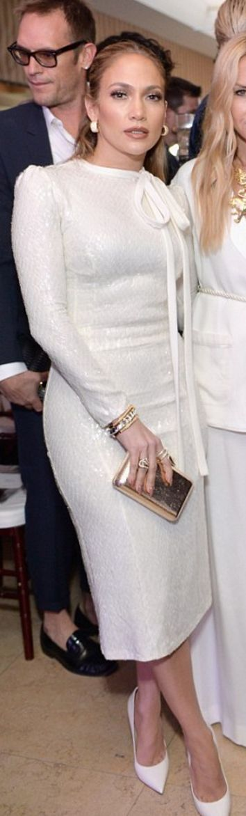 Who made  Jennifer Lopez's jewelry, white sequin bow dress, and clutch handbag?