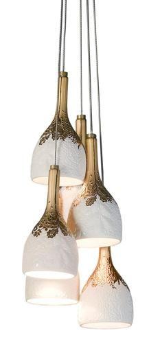 Contemporary copper and white cluster pendant light.