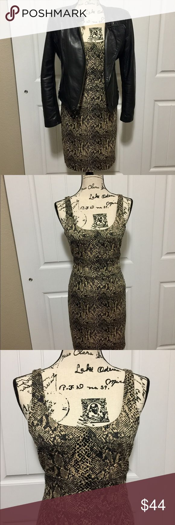 Michael Kors snakeskin-pattern dress This sleeve-less Michael Kors dress with fun snakeskin pattern is awesome!  It is lined and check out the photos to see the bodice-details.  Just what you need for a fun office-dress or even a night out! MICHAEL Michael Kors Dresses Midi