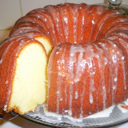 THIS 7-Up Cake is the BOMB! I like to use a flute pan because i like a crunchy top. But a as a gift this way is prettier.