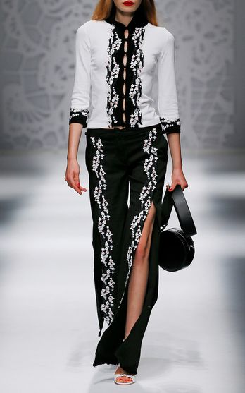 The designer: Sexy, feminine silhouettes and rose florals are the hallmarks of Anna Molinari's Italian label.  This season it's about: Among romantic lace and polkadots, Cheongsam silhouettes and ethereal Lily of the Valley embroideries is a fabulous black stretch denim kimono jacket (the new shape now trending!).