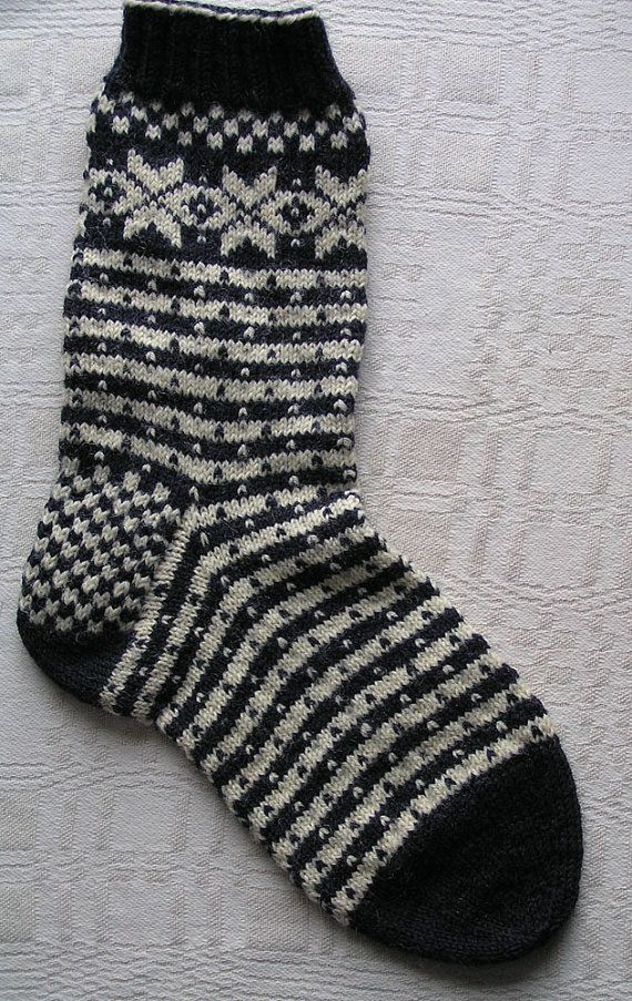 These socks are designed based on the historic Fana Cardigan from Norway, using the traditional Blocks pattern on the heel, the Star pattern