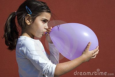 Girl Blowing Up Balloon Royalty Free Stock Photography - Image: 23524097