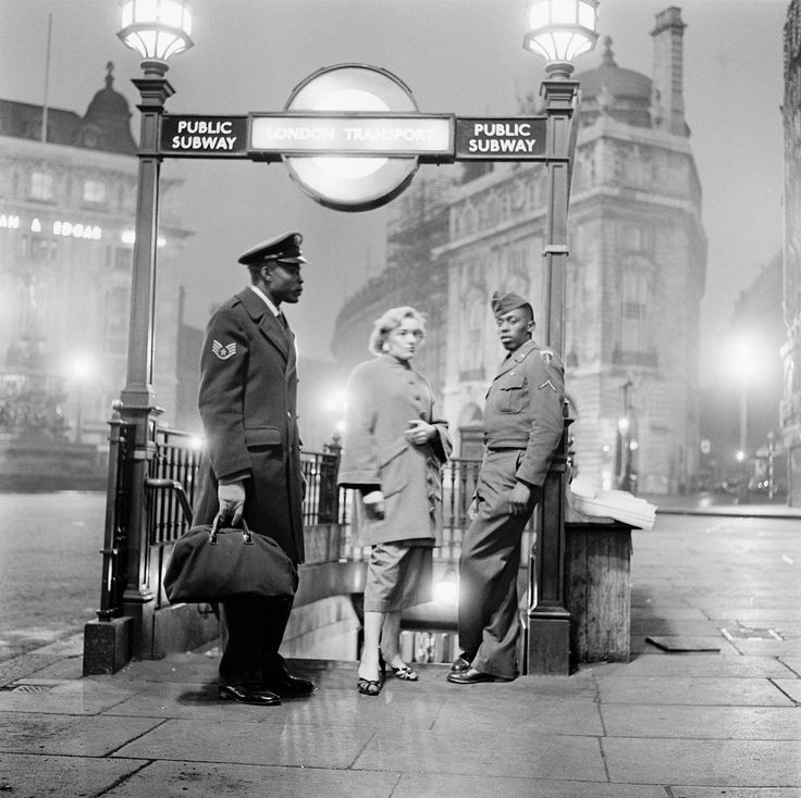 1955: ..♥♥..All-night dancing After leaving the 'Club Americana', a Saturday night jazz club open from midnight until 7 a.m.,...♥♥..  American troops and their girlfriends wait at Piccadilly Circus Station for the first train home, London, 25th November 1955