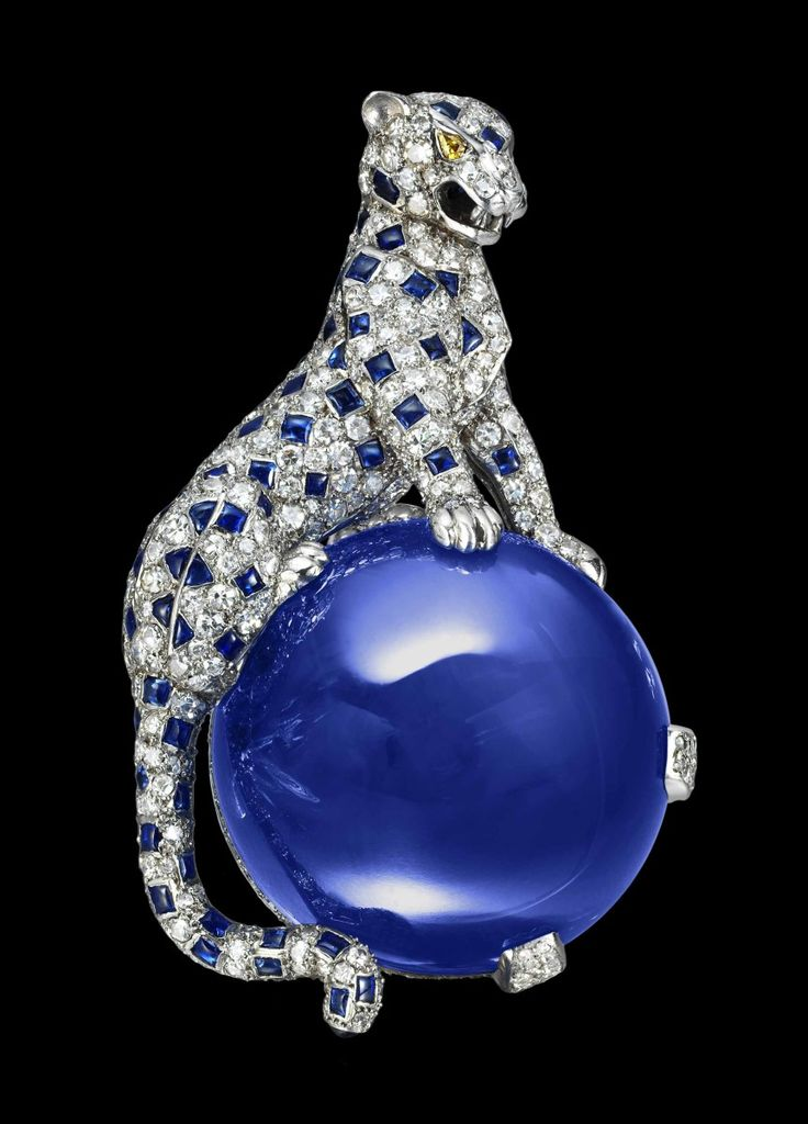 Panther Clip Brooch, Cartier Paris, 1949. Platinum, white gold, single-cut diamonds, two pear-shaped yellow diamonds (eyes), one 152.35-carat Kashmir sapphire cabochon, and sapphire cabochons (spots). This panther is the second three-dimensional example that Cartier made for the Duchess of Windsor (the first one surmounted an emerald cabochon).