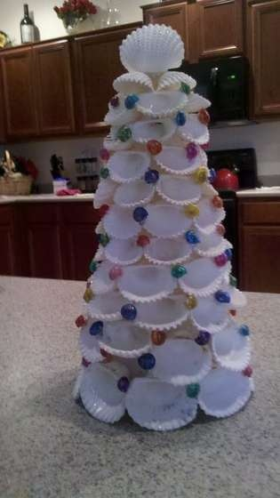 Seashell Christmas Tree----I have one done in oyster shells and one done in clam shells but I leave mine out all year not just at Christmas---part of my heritage...