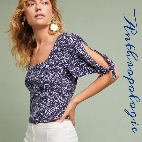 """Shop Women's Anthropologie Blue White size L Blouses at a discounted price at Poshmark. Description: Mauve collection Blouse in navy and white patterned Viscose features a cropped silhouette, tie- sleeve details, easy pull- on style. An anthropologie exclusive. Approx measurements: length 21"""", bust 38-40"""", waist 34-36"""", stretchy back for hip area. Sold by britgirl2. Fast delivery, full service customer support."""