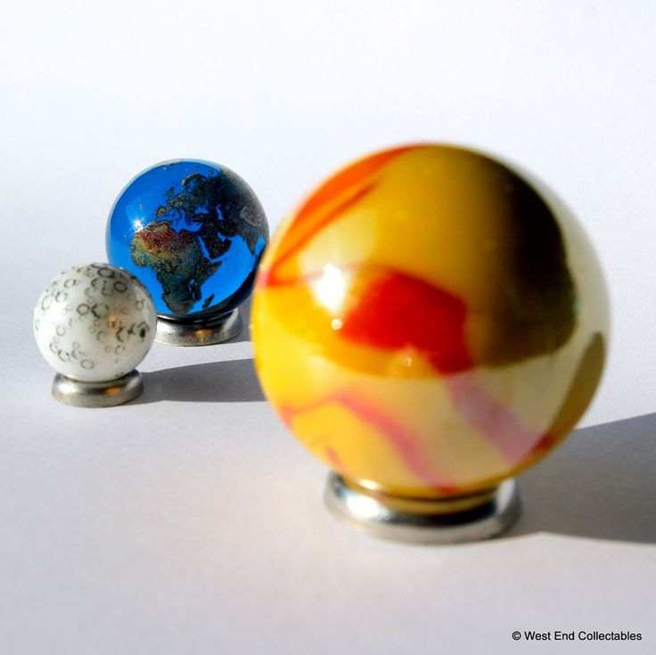 Solar Eclipse Glass Marble Set - Sun, Earth & Moon - World Planet Gaea Terra. Large Sun Marble measures 35mm diameter in vibrant yellow with red and orange currents across its face; an artistic interpretation of the sun dominating the other Globes.