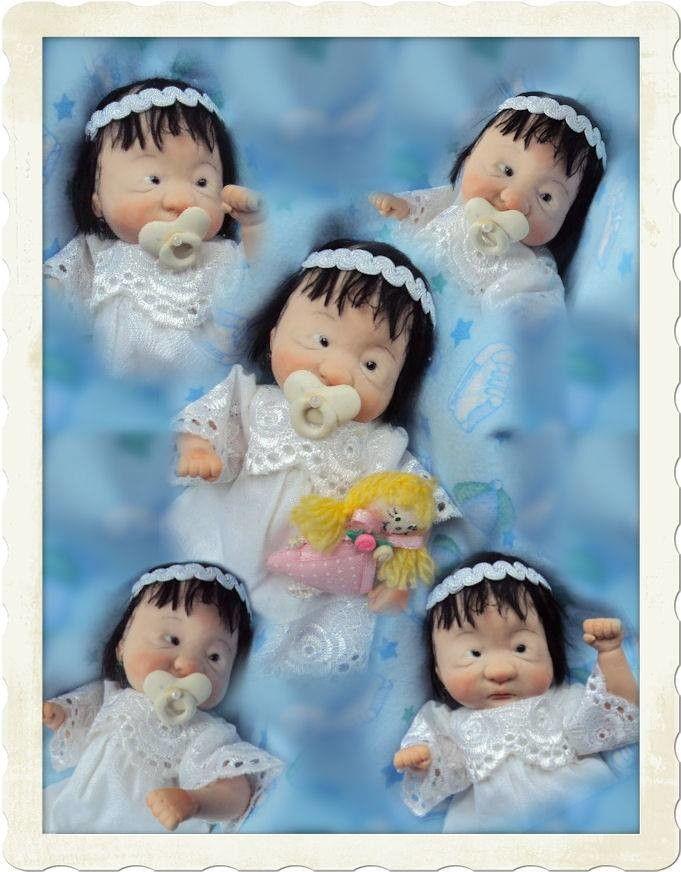 Chinese Baby girl Jingfei???), seu nome significa Cheiro do Outono! <br>15 cm, acompanha: Bonequinha de tecido, mamadeira, chupeta removível, meias, sapatos, roupinha removível, mini pomada hiploglos e uma linda manta feita a mão! Muito obrigado a minha artista gráfica Celina Sandoval, que gentilmente, me deu mais este presente com a maior boa vontade! Obrigado Celina, desta vez você <br>se superou! <br>Eu a esculpi com um tom de polymerclay que é especial para fazer bebês asiáticos sem uso…