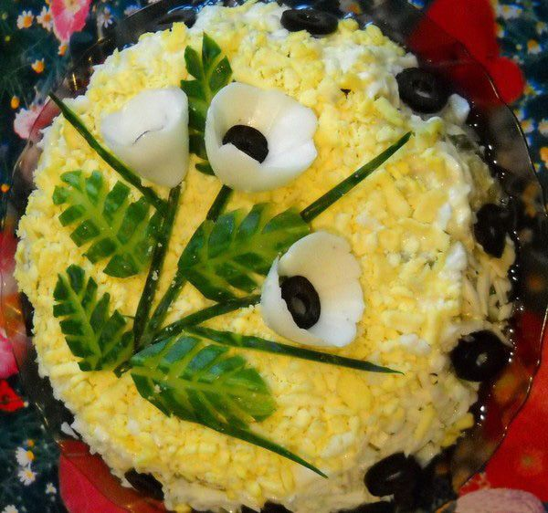 Pretty decoration for egg salad - the white flowers are the egg whites from boiled eggs with olive centers