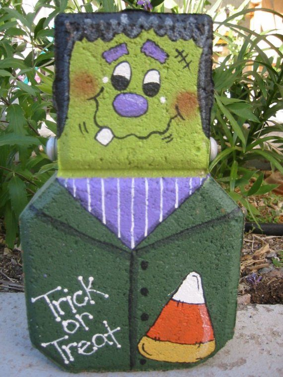 This is one of my Patio People. It is made from a concrete paver and painted with Patio Paint (like everything else I paint) to stand up to