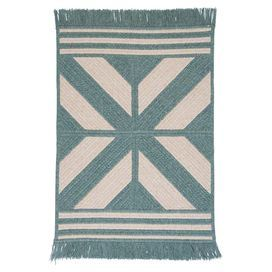 Braided and reversible wool-blend rug with a Southwestern motif and fringe trim. Made in the USA.  Product: RugConstruction Material: 65% Polyester and 35% woolColor: GreenFeatures:  Made in the USABraidedReversible Note: Please be aware that actual colors may vary from those shown on your screen. Accent rugs may also not show the entire pattern that the corresponding area rugs have.Cleaning and Care: Vacuum with hard surface attachment only. Spot clean with any common household cleaner