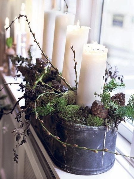 Winter simple arrangement of candles and naturals in a box or metal container
