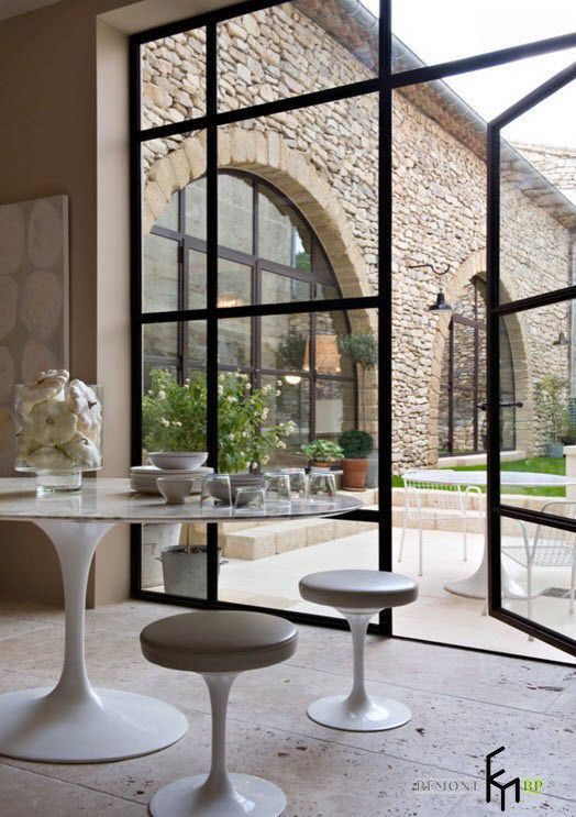 A Smart Simply Round Table With Nice Stools And Glass Apparatus With Large Glass Window Beautiful Country House in Italy with Warm Interior Home design
