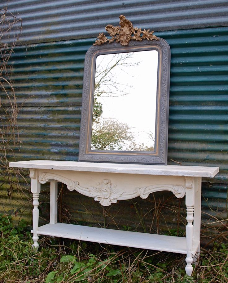 Moth Interiors Beautiful Antique French mirror Louis Phillippe. Serving Table reclaimed timbers and 19th century French carvings hand crafted in our Sussex workshop.
