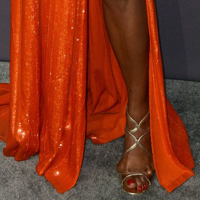 Naomi Campbell showing off her feet in metallic sandals