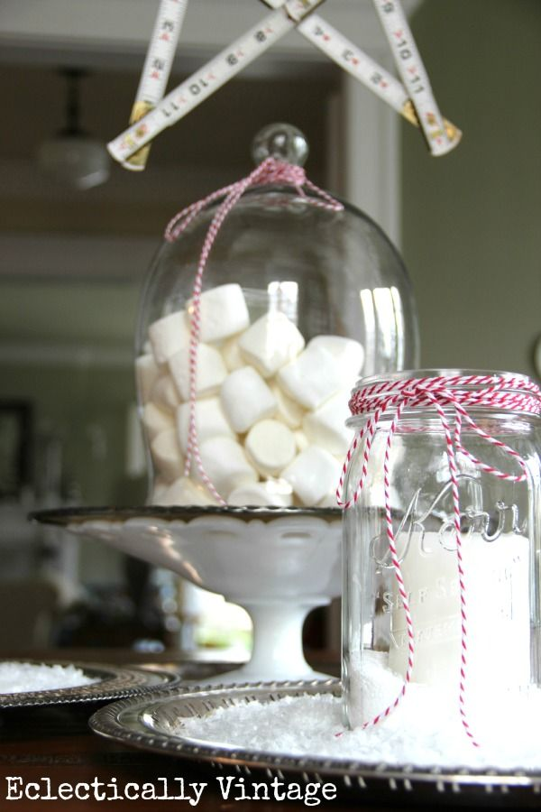 Winter Centerpiece  - white, silver, glowing candles and some bakers twine.  Marshmallows, sugar cubes, etc.  Yeah!