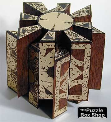 """Moveable handmade Lament Configuration. Brass inlaid mahogany. """"What's your pleasure, sir?"""""""