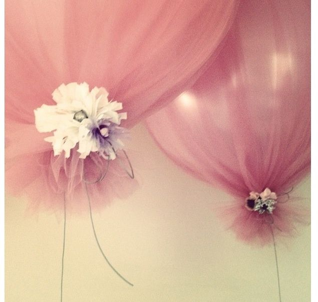 Tulle wrapped over balloons tied with ribbon and flowers. Um...why have I never seen this? Brilliant!