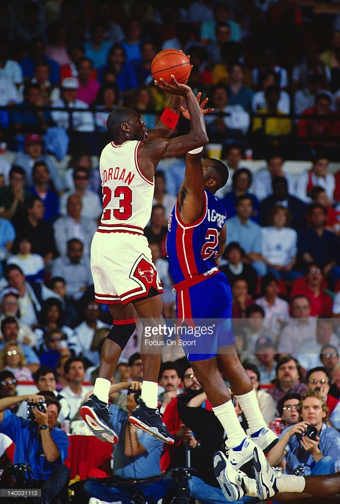 Michael Jordan #23 of the Chicago Bulls shoots over Mark Aguirre #23 of the Detroit Pistons during an NBA basketball game circa 1989 at the Chicago Stadium in Chicago, Illinois. Jordan played for the Bulls from 1984-93 and 1995 - 98.