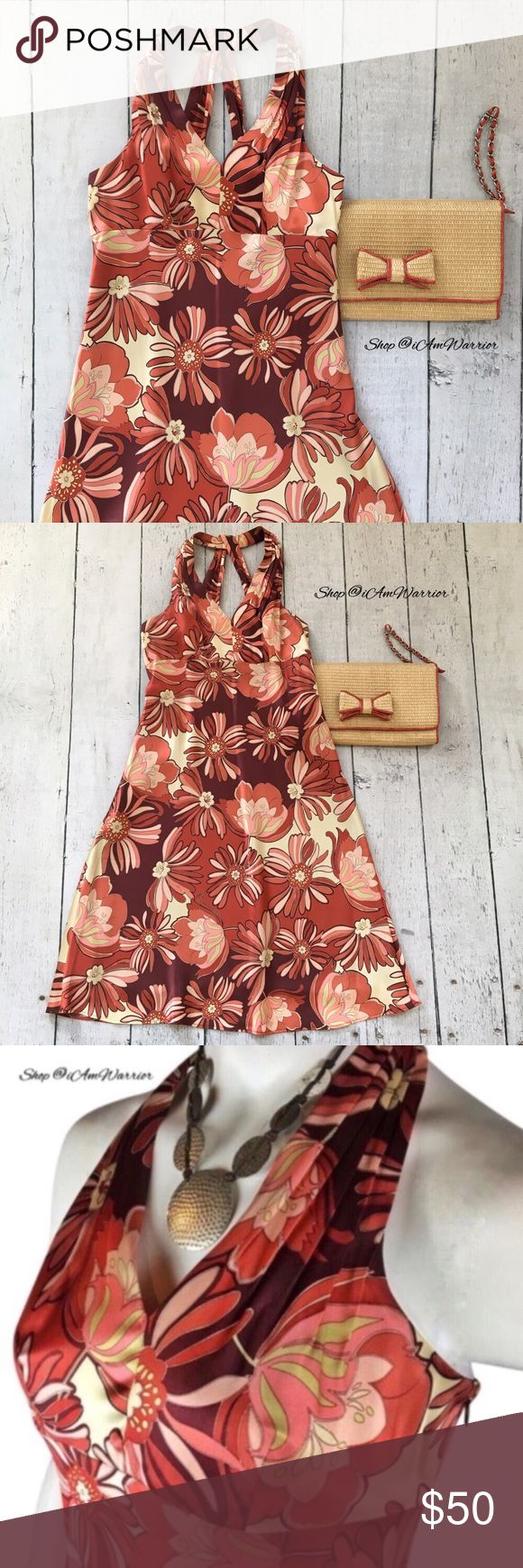 Ann Taylor Loft silk floral print dress Gorgeous Ann Taylor Loft silk blend empire waist halter dress. Pleated shoulder detail, twisted criss cross halter back. Excellent condition, smoke free home. Burgundy, salmon, pink & ivory floral print. Purse sold separately. Please read recently updated bio regarding closet policies prior to any inquiries. LOFT Dresses Midi