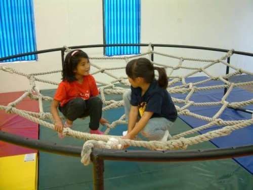 playground spider web with old trampoline