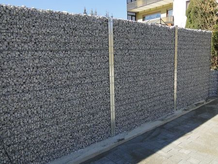 Check out https://www.gabionsupply.com!  Gabion Baskets make it easy to create the effects of a stone wall without massive excavation.