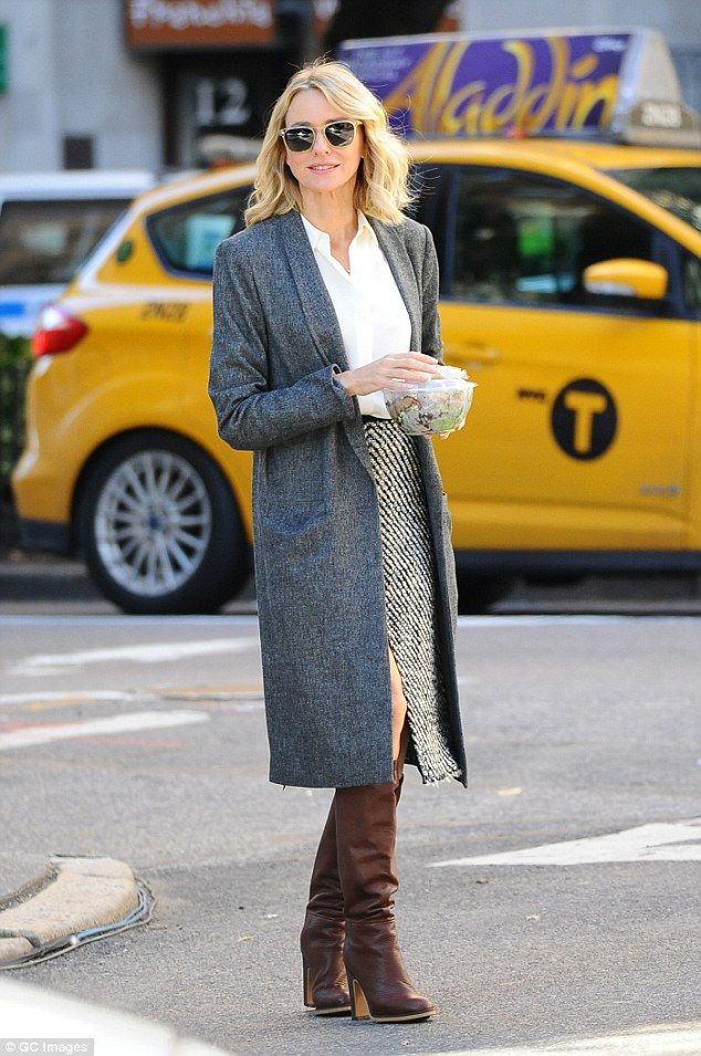 Headturner: Naomi Watts looked stylish in a striped skirt and cream blouse paired with a d...