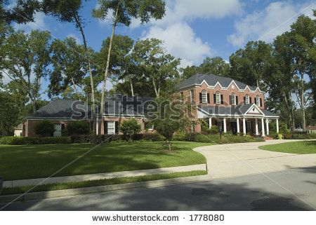 stock photo : New red brick Colonial style house exterior with porch