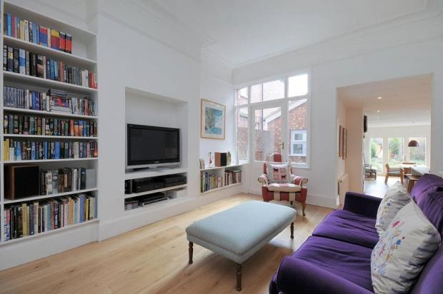 Keep the chimney and build the TV unit into it