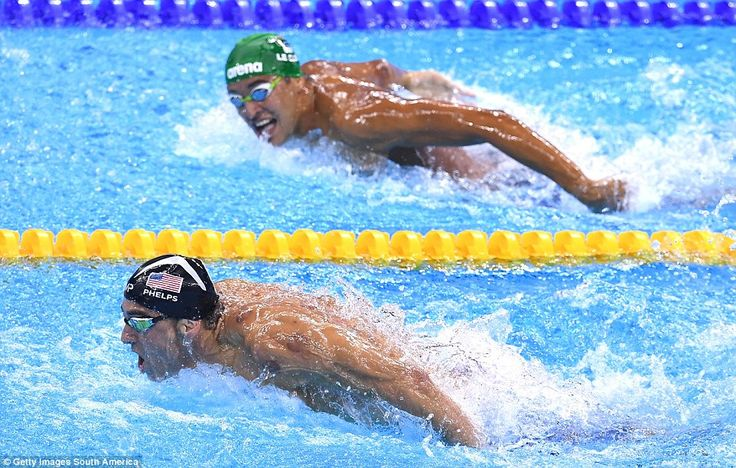 USA swimmer Michael Phelps leadsSouth Africa's Chad le Clos before claiming a 20th Olympic gold medal at the Rio Games