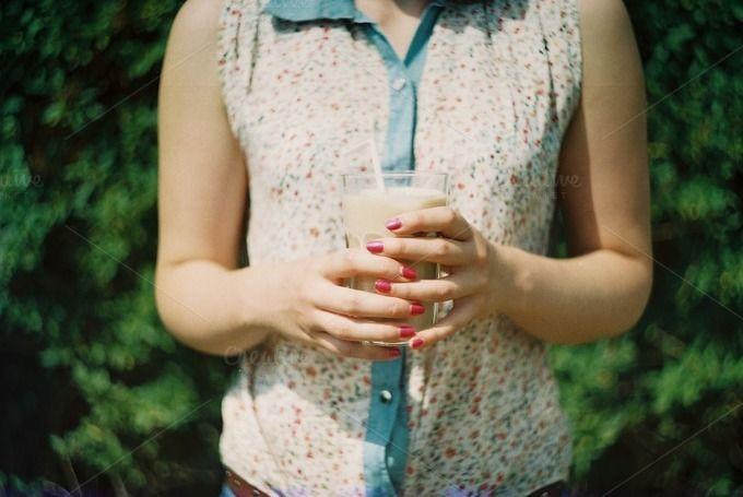 Girl holding a frappe by Kasia Górska on @creativemarket #female #stockphotography #summer #frappe #stockphoto