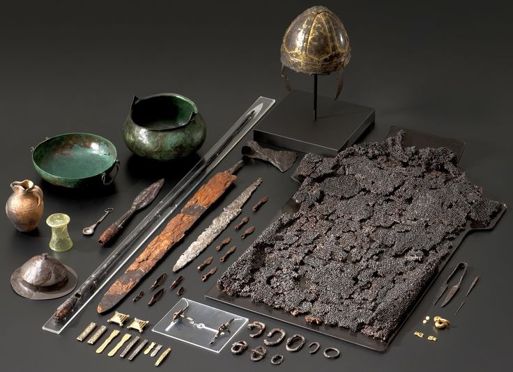 Early Medieval grave findings from Gammertingen Germany, 6th century, the princely man was wearing a golden helmet and mail armor. Beside him lay his weapons including a sword, an ax, a throwing spear, and an ornate lance. In addition different items such fine dinnerware, silver bridle, comb and scissors, Württemberg State Museum, Stuttgart.