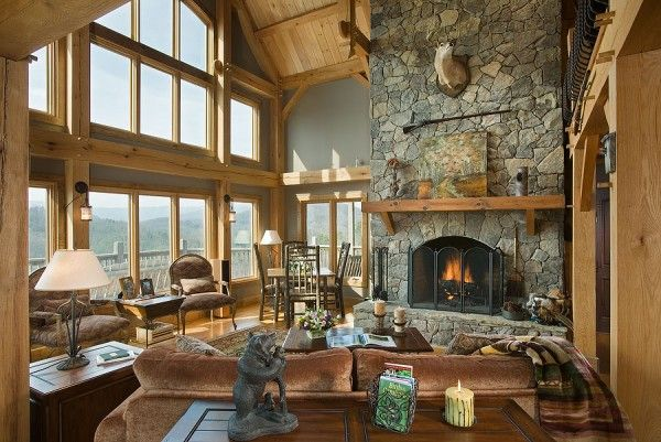 Wall of windows in this cozy timber frame home by