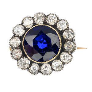 An early 20th century silver and 9ct gold sapphire and diamond cluster brooch.